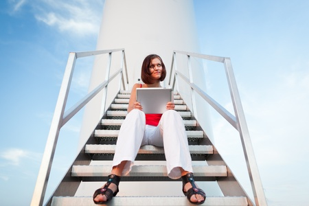 Tablet computer concept: pretty young woman using a tablet computer Stock Photo - 11101663