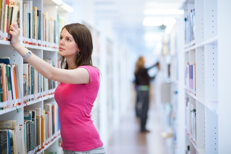 pretty, female college student in a library (shallow DOF; color toned image) Stock Photo - 11238503