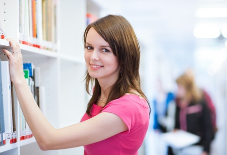 pretty, female college student in a library (shallow DOF; color toned image) Stock Photo - 11238504