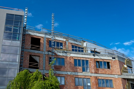 residential building construction site on a lovely summer day (color toned image) Stock Photo - 11230327