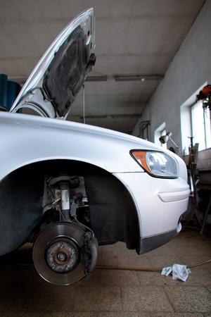 automobile repair shop: inside a garage (shallow DOF; color toned image) Editorial