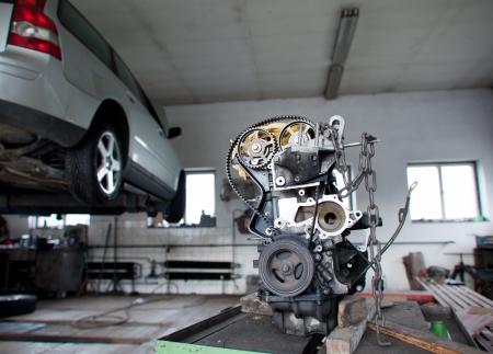 auto repair shop: inside a garage (shallow DOF; color toned image) Editorial