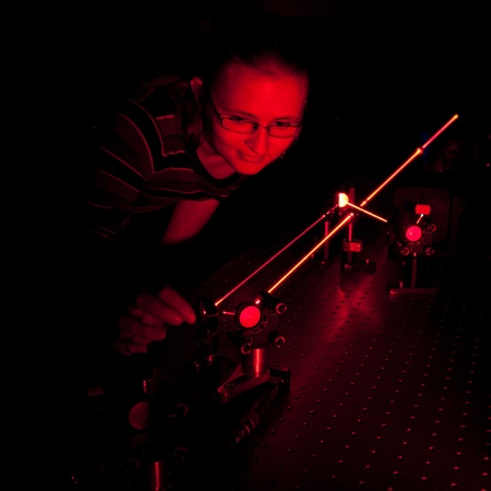 female scientist doing research in a quantum optics lab photo