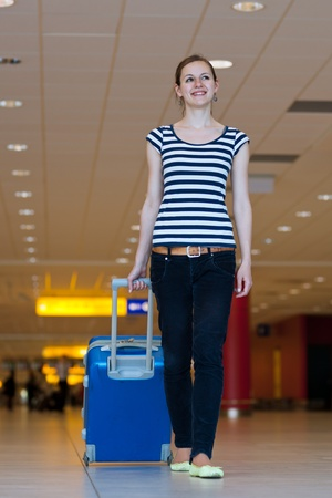 Pretty young female passenger at the airport (shallow DOF; color toned image) Stock Photo - 11303411