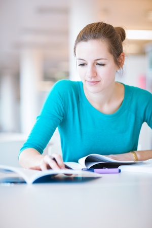 female college student in a library (shallow DOF; color toned image) Stock Photo - 11303471