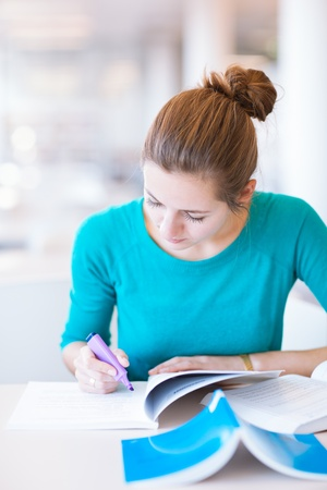 choose university: female college student in a library (shallow DOF; color toned image) Stock Photo