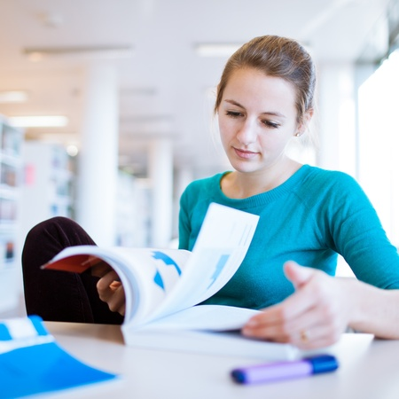 female college student in a library (shallow DOF; color toned image) Stock Photo - 11303456