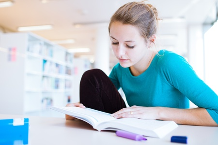female college student in a library (shallow DOF; color toned image) Stock Photo - 11303482