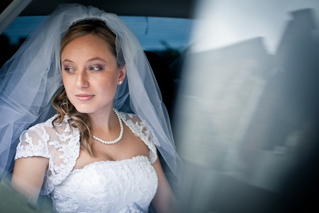 Portrait of a beautiful young bride waiting in the car on her way to the wedding ceremony Stock Photo - 11352577