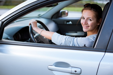 Pretty young woman driving her new car Stock Photo - 11303776