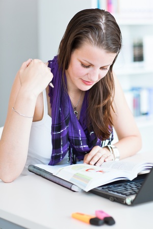 high class: pretty female college student studying in the university librarystudy room  Stock Photo