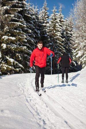 snow ski: Cross-country skiing: young man cross-country skiing on a lovely sunny winter day Stock Photo