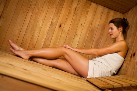 steam room: Young woman relaxing in a sauna