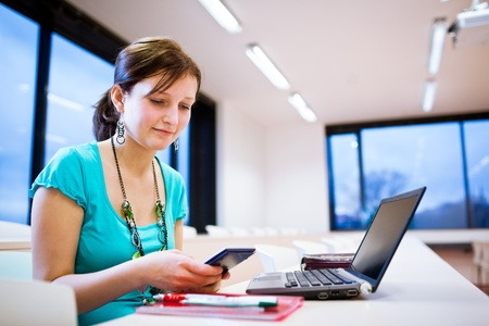 Pretty young female student with laptop on college/university campus Stock Photo - 11761801