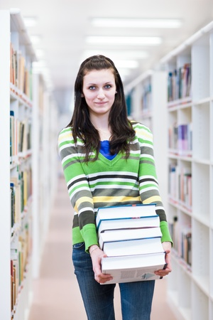 pretty, young college student in a library (shallow DOF; color toned image) photo