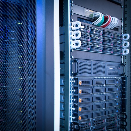 server rack: Server rack cluster in a data center (shallow DOF; color toned image)