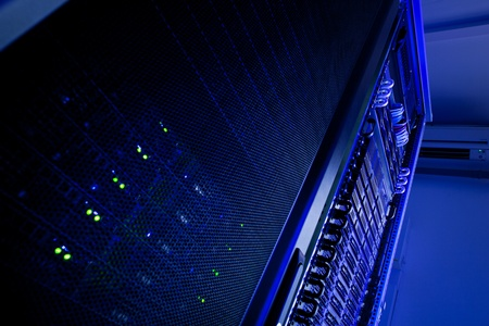 Server rack cluster in a data center (shallow DOF; color toned image) Stock Photo - 11940548