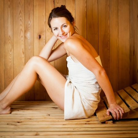 body temperature: Young woman relaxing in a sauna