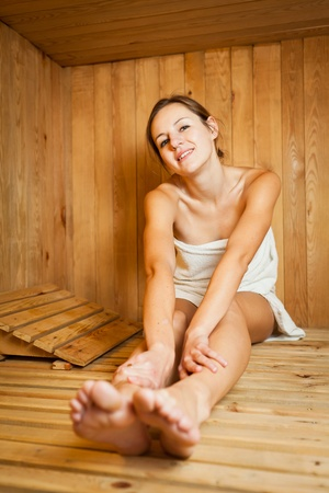 finnish: Young woman relaxing in a sauna