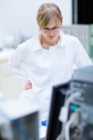 laboratory technician: female researcher carrying out research experiments in a chemistry lab (color toned image) Stock Photo