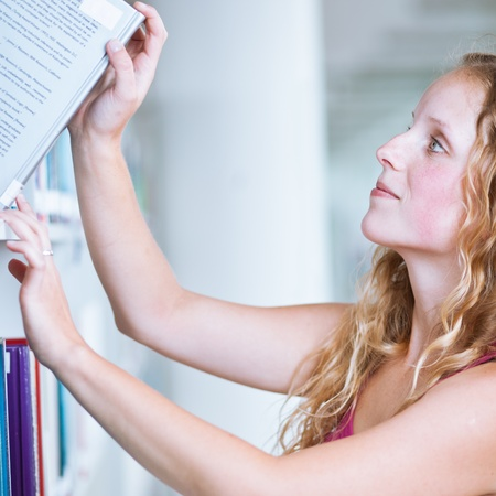 pretty female college student in a library (shallow DOF; color toned image) photo