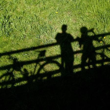 siluetas: two mountain bikers silhouettes during a halt on a bridge Stock Photo