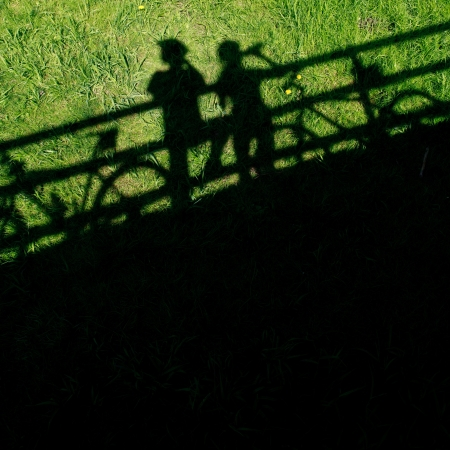 tours: two mountain bikers silhouettes during a halt on a bridge Stock Photo
