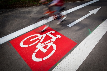 bicycle wheel: urban traffic concept - bikecycling lane sign in a city