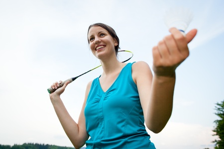 kerchief: Pretty, young woman playing badminton in a city park on a lovely summer day (shallow DOF) Stock Photo