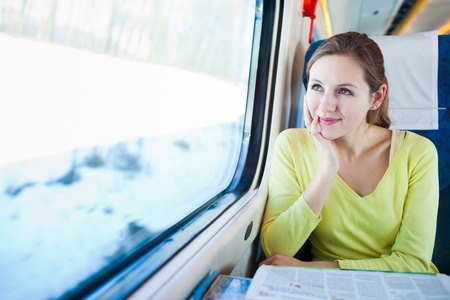 Young woman traveling by train photo