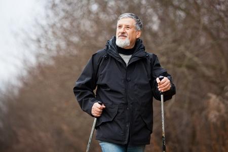 action fund: Senior man nordic walking Stock Photo