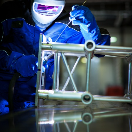 welding: WELDER AT WORK (color toned image; shalow DOF) Stock Photo