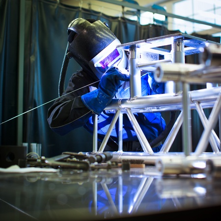 metallurgy: WELDER AT WORK (color toned image; shalow DOF) Stock Photo