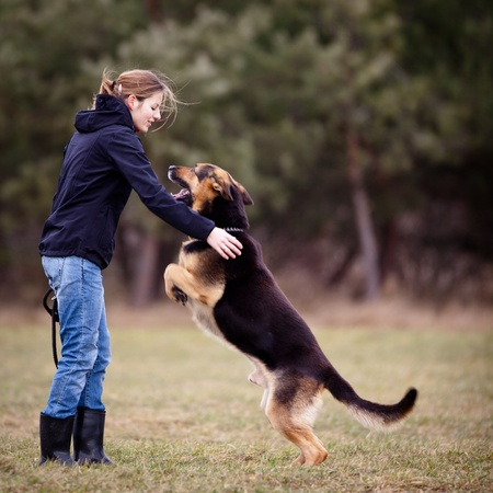 obedience: Master and her obedient (German shepherd) dog