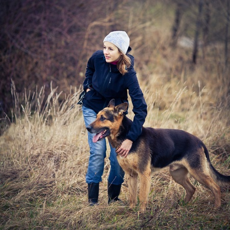 german shepherd on the grass: Master and her obedient (German shepherd) dog
