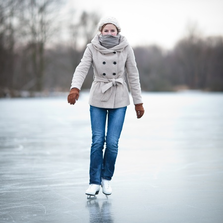 Young woman ice skating outdoors on a pond on a freezing winter day Stock Photo - 12405849