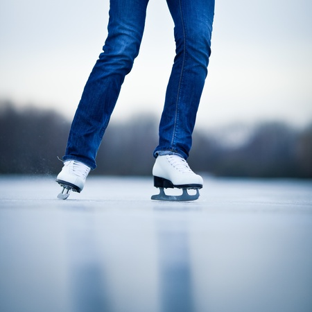 Young woman ice skating outdoors on a pond on a freezing winter day Stock Photo - 12405854