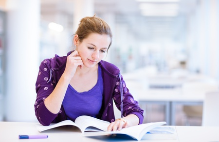 female college student in a library (shallow DOF; color toned image) Stock Photo - 12405975