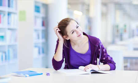 female college student in a library (shallow DOF; color toned image) Stock Photo - 12405872