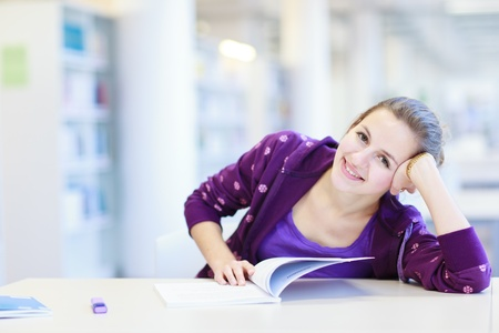 female college student in a library (shallow DOF; color toned image) Stock Photo - 12405861