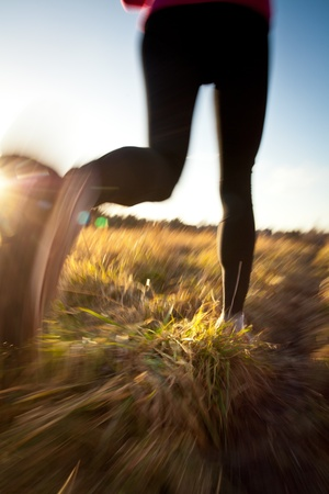 Young woman running outdoors on a lovely sunny winter/fall day (motion blurred image) Stock Photo - 12406000
