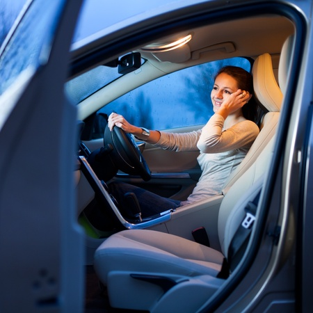 inside car: Pretty young woman driving her new car Stock Photo