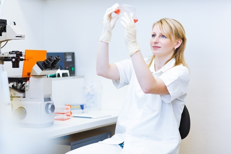 portrait of a female researcher doing research in a lab  color toned image photo