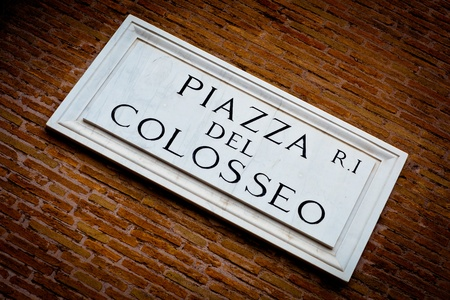 tourist guide: Piazza del Colosseo - detail of a street plate near Colosseum in Rome, Italy