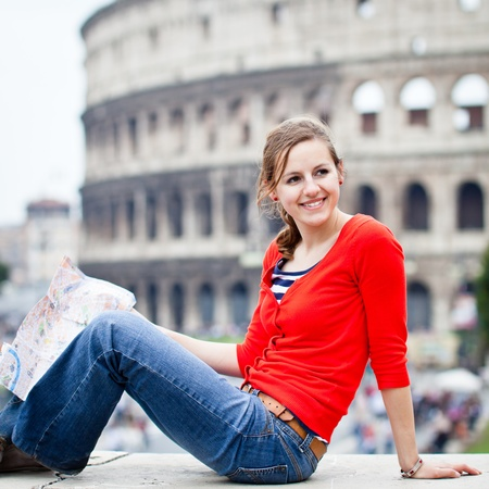 Portrait of a pretty, young, female tourist in Rome, Italy (with Colosseum in the background) photo