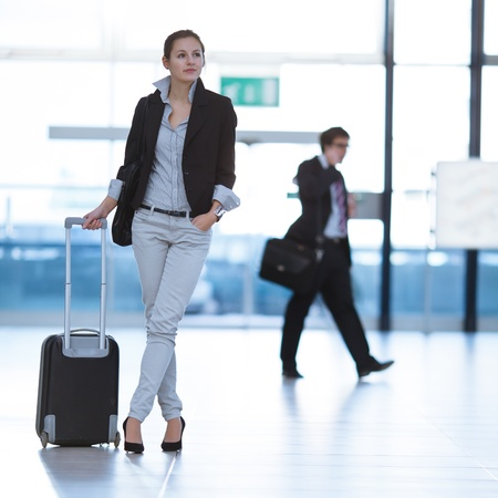 Pretty young female passenger at the airport (shallow DOF; color toned image) Stock Photo - 12465924