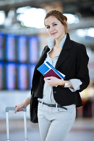 Pretty young female passenger at the airport (shallow DOF; color toned image) photo