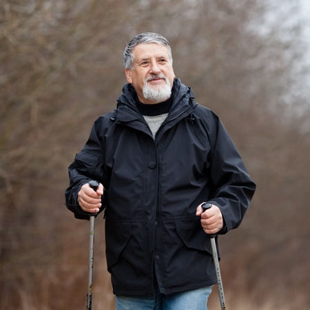 action fund: Senior man nordic walking Stock Photo