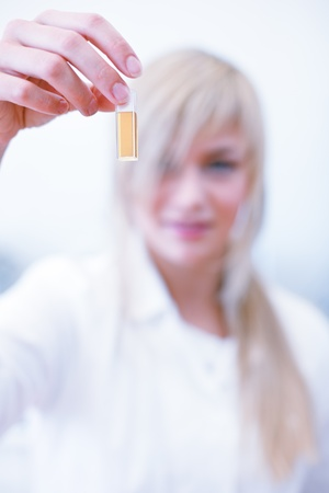 recipient: Closeup of a female researcherchemistry student carrying out experiments in a lab