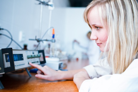 recipient: Closeup of a female researcherchemistry student carrying out experiments in a lab, MEASURING PH